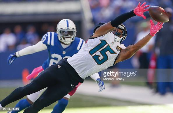 Allen Robinson of the Jacksonville Jaguars reaches for a pass as Darius Butler of the Indianapolis Colts watches at Lucas Oil Stadium on October 4...