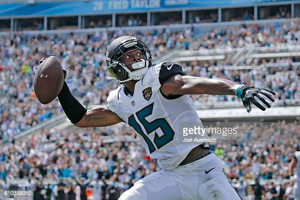 Allen Robinson of the Jacksonville Jaguars throws the ball into the stands after catching a pass for a touchdown against the Baltimore Ravens during...