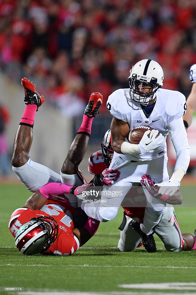 Allen Robinson #8 of the Penn State Nittany Lions is brought down by Tyvis Powell #23 and Doran Grant #12 of the Ohio State Buckeyes after a pass reception in the third quarter at Ohio Stadium on October 26, 2013 in Columbus, Ohio. Ohio State defeated Penn State 63-14.