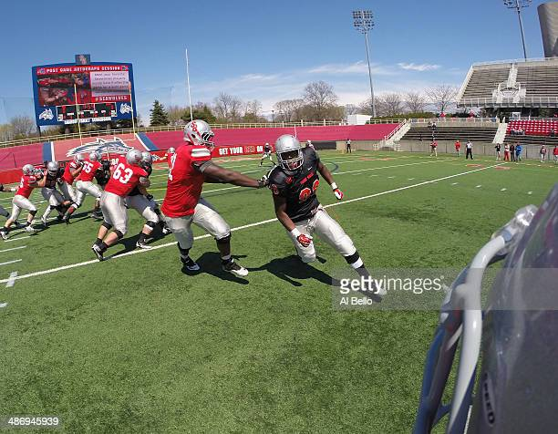 Allen Singleton of the Stony Brook Defense rushes the Quarterback Conor Bednarski during their Spring Football Game at Kenneth P LaValle Stadium on...