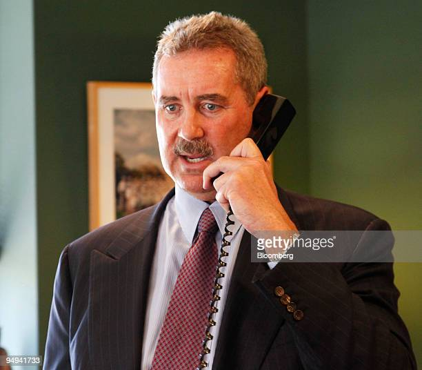 R Allen Stanford chairman president and chief executive officer of Stanford Financial Group Co talks on the phone prior to an interview in the office...