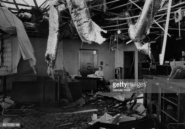 L Allen Weaver manager of the Commercial National Bank in Grand Island sits in the rubble of the bank after a series of twisters which ravaged the...