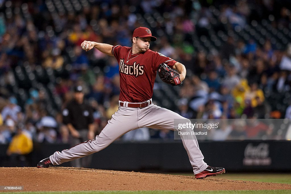 <a gi-track='captionPersonalityLinkClicked' href=/galleries/search?phrase=Allen+Webster&family=editorial&specificpeople=10504749 ng-click='$event.stopPropagation()'>Allen Webster</a> #27 of the Arizona Diamondbacks pitches against the Colorado Rockies a game at Coors Field on June 24, 2015 in Denver, Colorado.