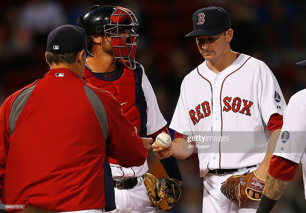 Allen Webster #64 of the Boston Red Sox is removed by John Farrell #53 in the 2nd inning against Minnesota Twins at Fenway Park on May 8, 2013 in Boston, Massachusetts.