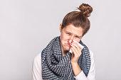 Allergy or virus concept. Closeup portrait of sick woman. Studio shot
