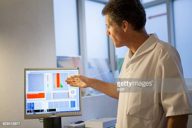 Allergy specialist practice in Geneva A patient takes a spirometry test to detect allergyrelated asthma The test measures the levels of nitric oxide...
