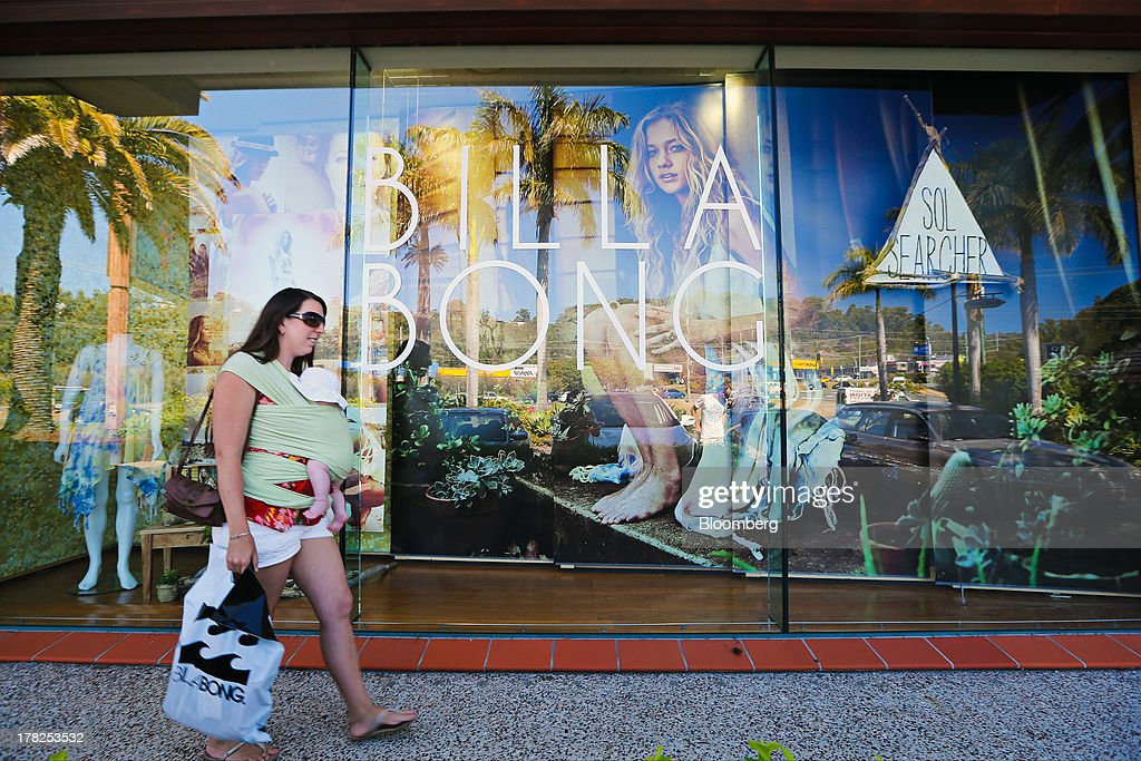 Alley Townsend walks past a window display of a Billabong International Ltd. retail store at the company's headquarters in Burleigh Heads, Australia, on Wednesday, Aug. 28, 2013. Billabong, the surf brand founded in 1973, helped sell Australian surfing culture worldwide and rose to a market value of A$3.84 billion ($3.45 billion) at its peak in 2007 said its 40-year-old surf brand was worthless after the companys losses tripled amid store closures, firings and a breach of debt terms. Photographer: Patrick Hamilton/Bloomberg via Getty Images