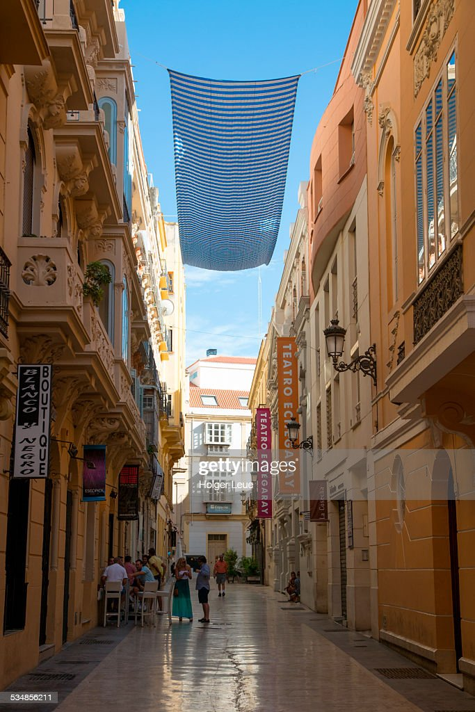 Alleyway with sun canopy in city center