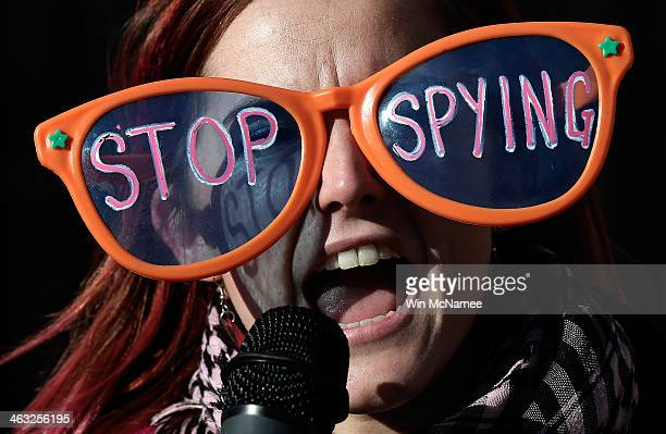 Alli McCracken joins activists protesting the surveillance of US citizens by the NSA outside the Justice Department where US President Barack Obama...