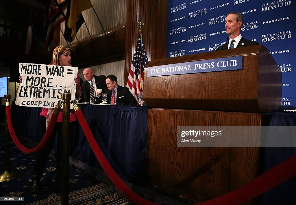 Alli McCracken of CODEPINK stages a protest as Chairman of the House Armed Services Committee Rep Mac Thornberry speaks during a National Press Club...