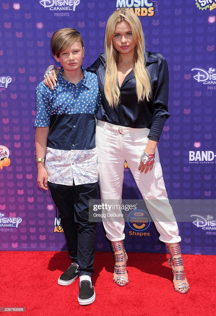 Alli Simpson and brother Tom Simpson arrive at the 2016 Radio Disney Music Awards at Microsoft Theater on April 30, 2016 in Los Angeles, California.