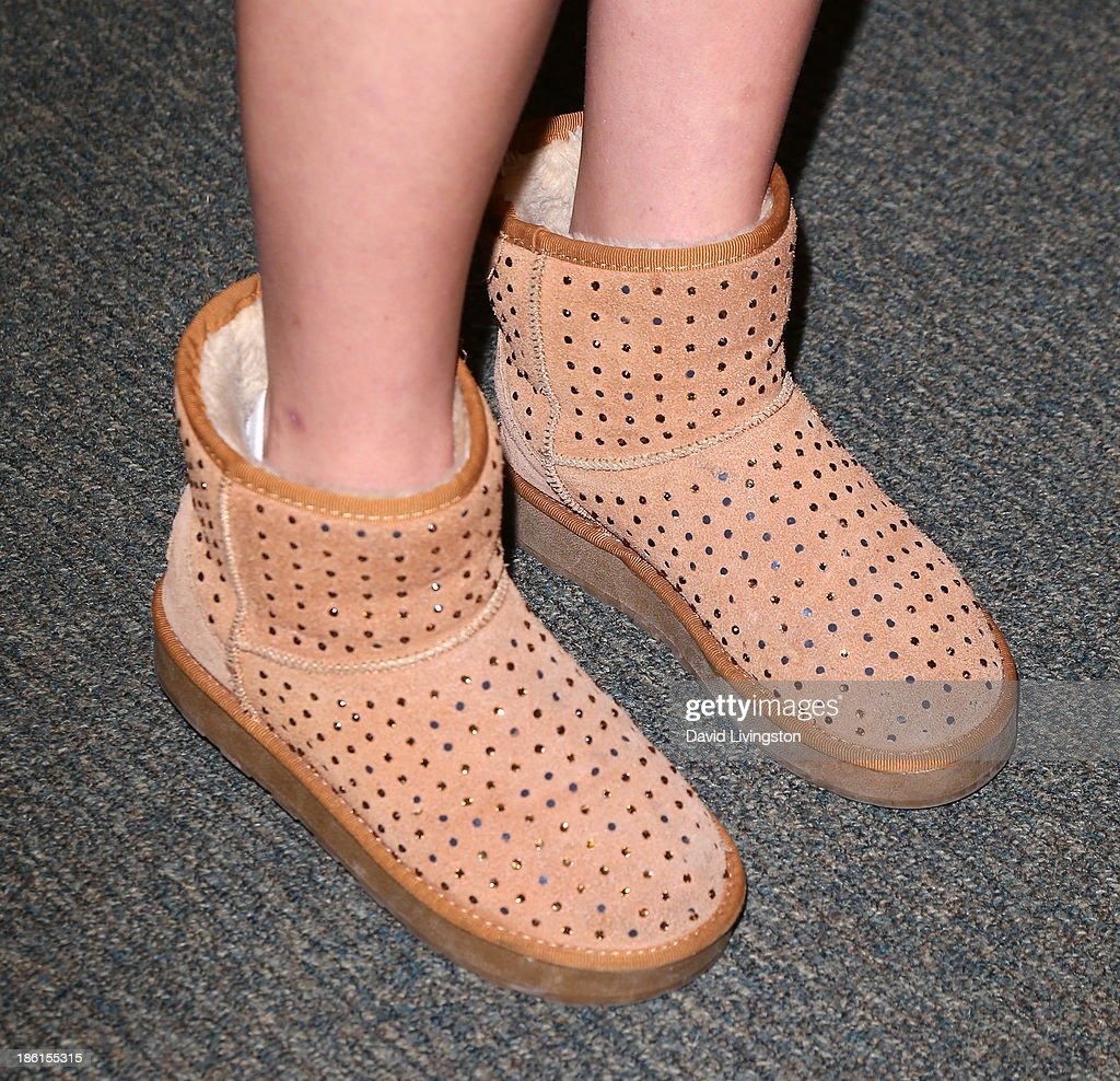 Alli Simpson (shoe detail) attends a signing for brother Cody Simpson's book 'Welcome to Paradise' at Barnes & Noble bookstore at The Grove on October 28, 2013 in Los Angeles, California.