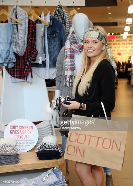 Alli Simpson attends Cody Simpson Celebrates 'I Give A Brick' Campaign at Cotton On on December 16 2014 in Santa Monica California