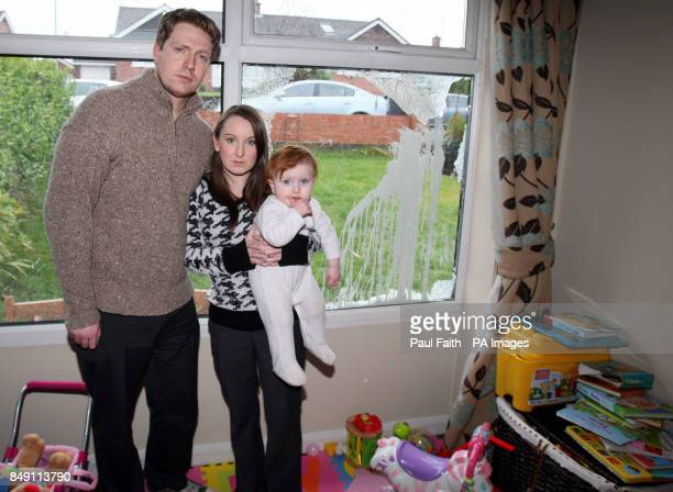 Alliance councillors Michael and Christine Bower's with their 17 month old daughter Grace at their home in Bangor Co Down which was attacked with...