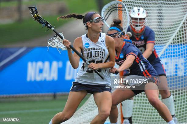 Allie Gorman of College of New Jersey is defended by Katelyn Neillands of Gettysburg College during the Division III Women's Lacrosse Championship...