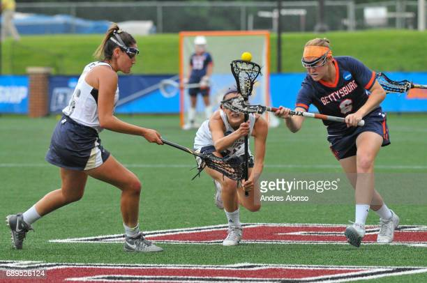 Allie Gorman of College of New Jersey scoops the ball in the final minute of the game defended by Caroline Jaeger of Gettysburg College during the...
