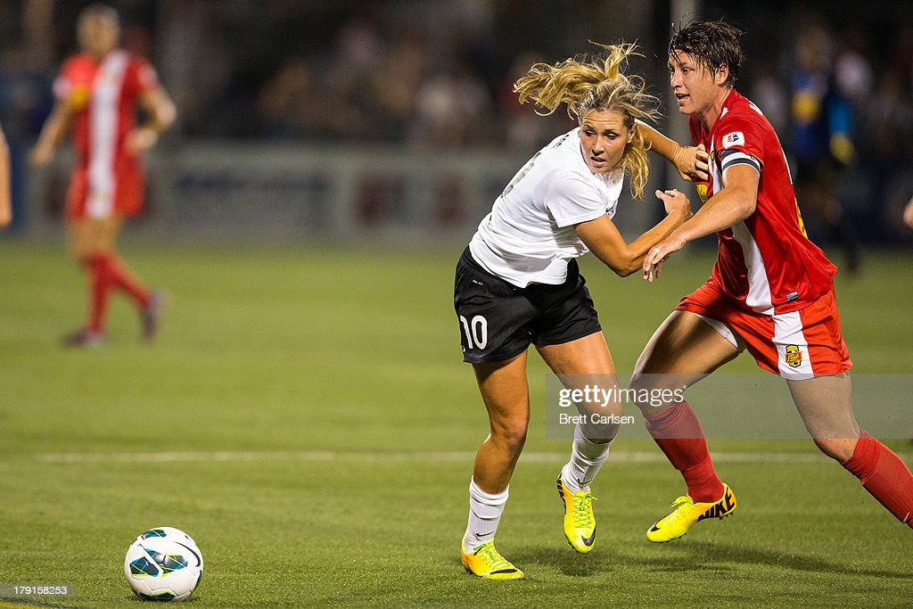 Allie Long #10 of Portland Thorns FC makes contact with Abby Wambach #20 of Western New York Flash as the two head for a loose ball in the National Women's Soccer League Championship at Sahlen's Stadium August 31, 2013 in Rochester, New York.