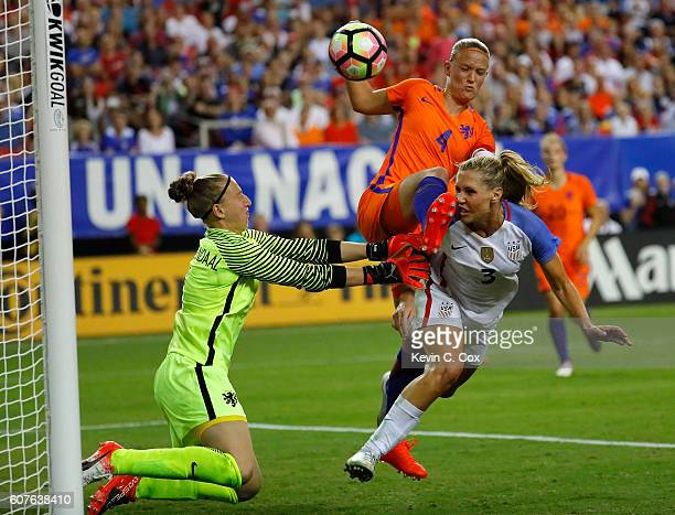 Allie Long scores a goal off a header against Mandy van den Berg and goalkeeper Sari van Veenendall of the Netherlands at Georgia Dome on September...