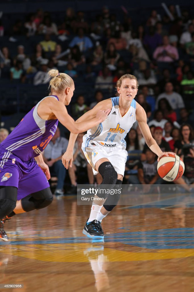 Allie Quigley #14 of the Chicago Sky moves the ball up-court against the Phoenix Mercury on July 11, 2014 at the Allstate Arena in Rosemont, Illinois.