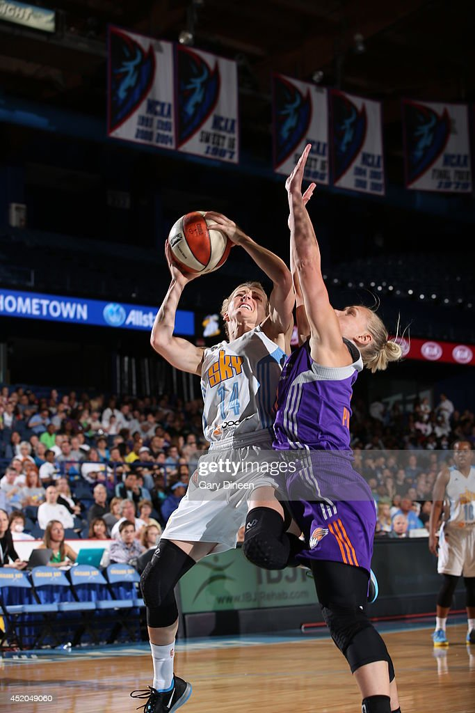 <a gi-track='captionPersonalityLinkClicked' href=/galleries/search?phrase=Allie+Quigley&family=editorial&specificpeople=5133567 ng-click='$event.stopPropagation()'>Allie Quigley</a> #14 of the Chicago Sky shoots the ball against the Phoenix Mercury on July 11, 2014 at the Allstate Arena in Rosemont, Illinois.