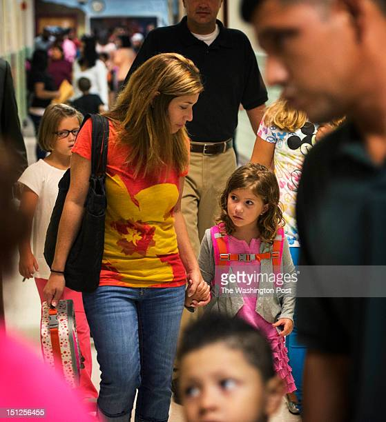 Allie Rutherford left walks her daughter 5yearold Grace to her classroom on the first day of school on Tuesday Sept 4 2012 Bailey's Elementary School...