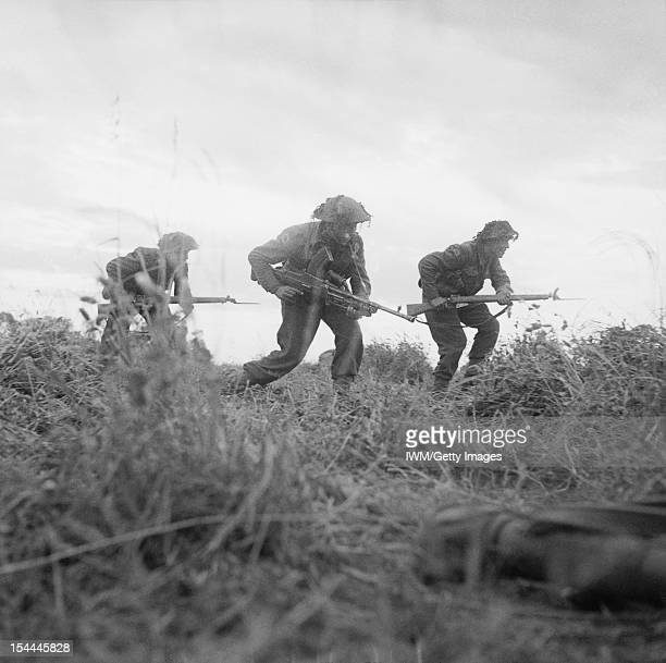 Allied Campaign In North West Europe Infantry of 8 Rifle Brigade 11th Armoured Divsion move forward cautiously near Eterville Normandy 29 June 1944