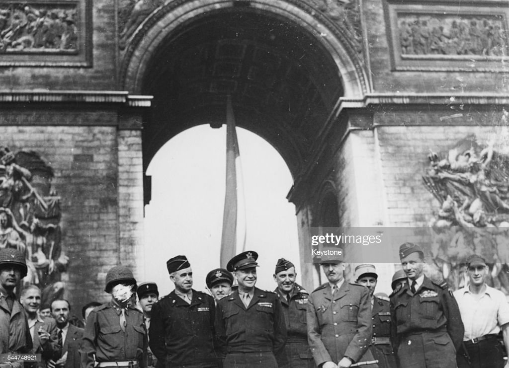 General Omar Bradley, General Dwight Eisenhower, General Marie-Pierre Koenig and Air Marshal Arthur Tedder, in front of the Arc de Triomphe during World War Two, Paris, August 28th 1944.