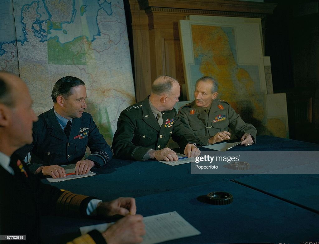 1944 - Allied Supreme Command in conference at their headquarters during World War Two. From L-R Air Chief Marshal Sir Arthur Tedder (1890-1967), General Dwight D. Eisenhower (1890-1969) and General Bernard Montgomery (1887-1976), England, February 1944.