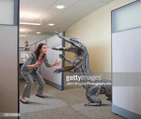 Alligator attacking businesswoman in office cubicle