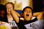 Allion A Salvador a sixth grader from Fort Lauderdale Florida yawns during the first oral round of the competition in the Grand Hyatt Hotel June 1...