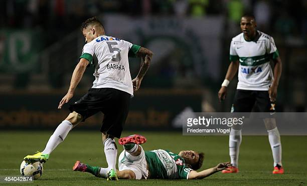 Allione of Palmeiras fights for the ball with Baraka of Coritiba during the match between Palmeiras and Coritiba for the Brazilian Series A 2014 at...