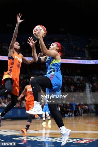 Allisha Gray of the Dallas Wings goes for a lay up against Courtney Williams of the Connecticut Sun on August 12 2017 at Mohegan Sun Arena in...