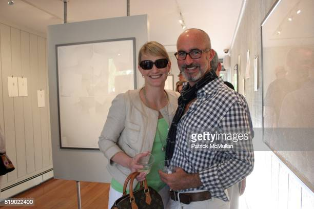 Allison BeyerClausen and Tim O'Brien attend Gustavo Bonevardi Opening at Gallery B on May 30 2010 in Sag Harbor New York