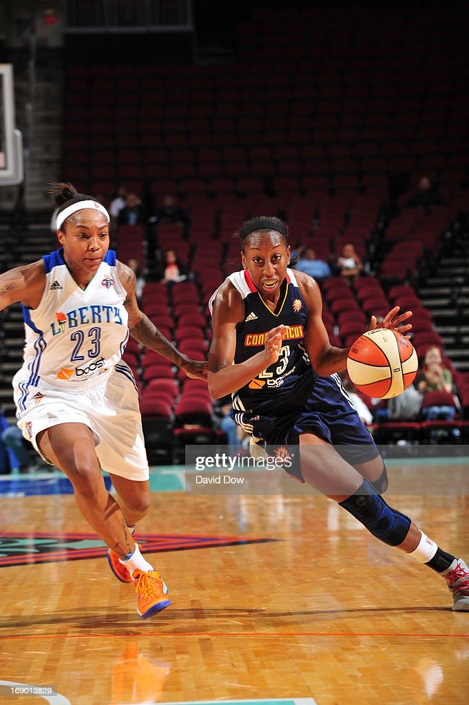 Allison Hightower #23 of the Connecticut Sun drives against <a gi-track='captionPersonalityLinkClicked' href=/galleries/search?phrase=Cappie+Pondexter&family=editorial&specificpeople=544600 ng-click='$event.stopPropagation()'>Cappie Pondexter</a> #23 of the New York Liberty during the WNBA game on May 18, 2013 at the Prudential Center in Newark, New Jersey.