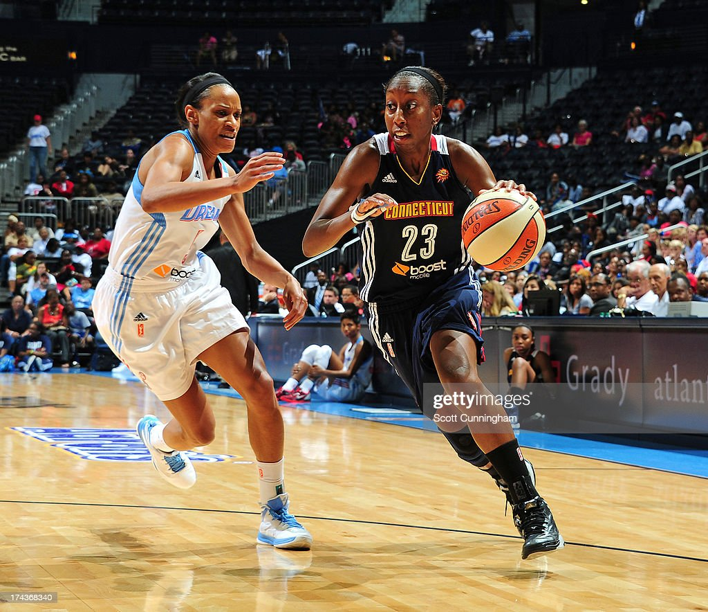 Allison Hightower #23 of the Connecticut Sun drives against the Atlanta Dream at Philips Arena on July 24, 2013 in Atlanta, Georgia.