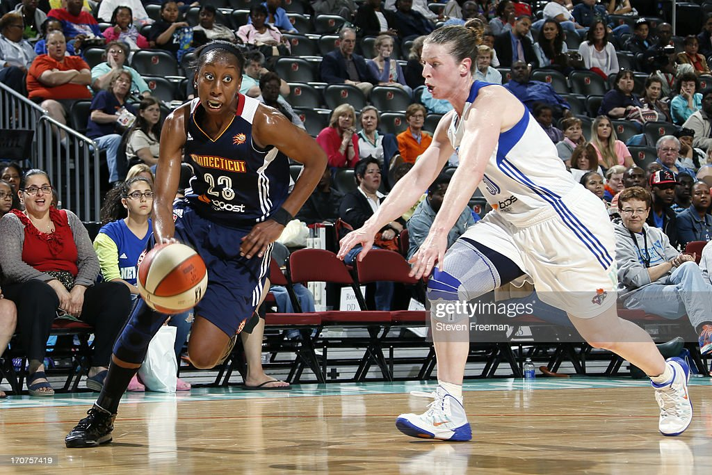 Allison Hightower #23 of the Connecticut Sun drives to the basket against the New York Liberty on June 14, 2013, at the Prudential Center in Newark, New Jersey NJ, June 14, 2013.