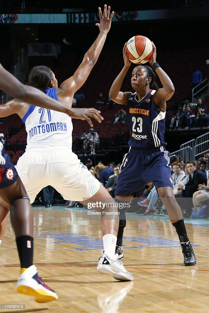 Allison Hightower #23 of the Connecticut Sun looks to pass the ball against the New York Liberty on June 14, 2013, at the Prudential Center in Newark, New Jersey NJ, June 14, 2013.