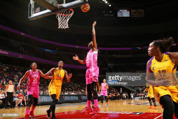 Allison Hightower of the Washington Mystics shoots the ball against the Los Angeles Sparks on August 16 2017 at the Verizon Center in Washington DC...