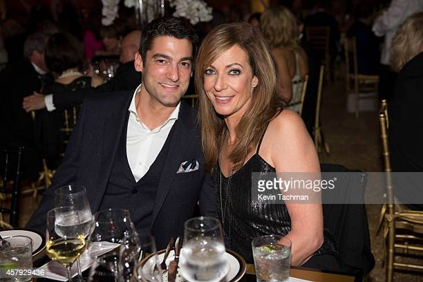 Allison Janney and Guest attend the TWO x TWO For AIDS And Art 2014 Gala and Auction on October 25 2014 in Dallas Texas