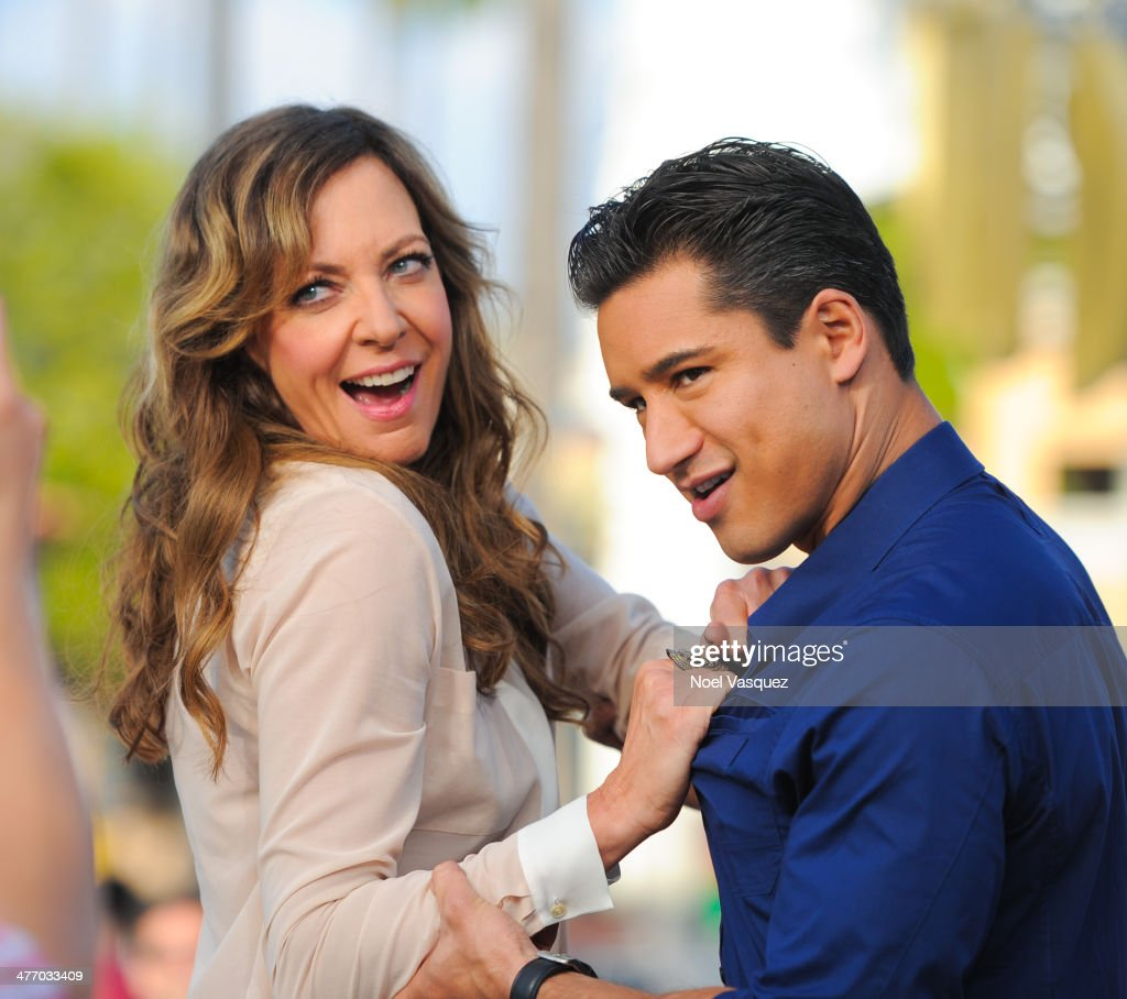 Allison Janney and Mario Lopez visit 'Extra' at Universal Studios Hollywood on March 6 2014 in Universal City California