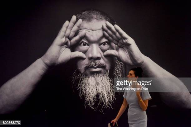 Allison Peck a PR person with the Hirshhorn Museum passes through the Ai Weiwei Trace at Hirshhorn exhibit at the Hirshhorn Museum on Monday June 26...