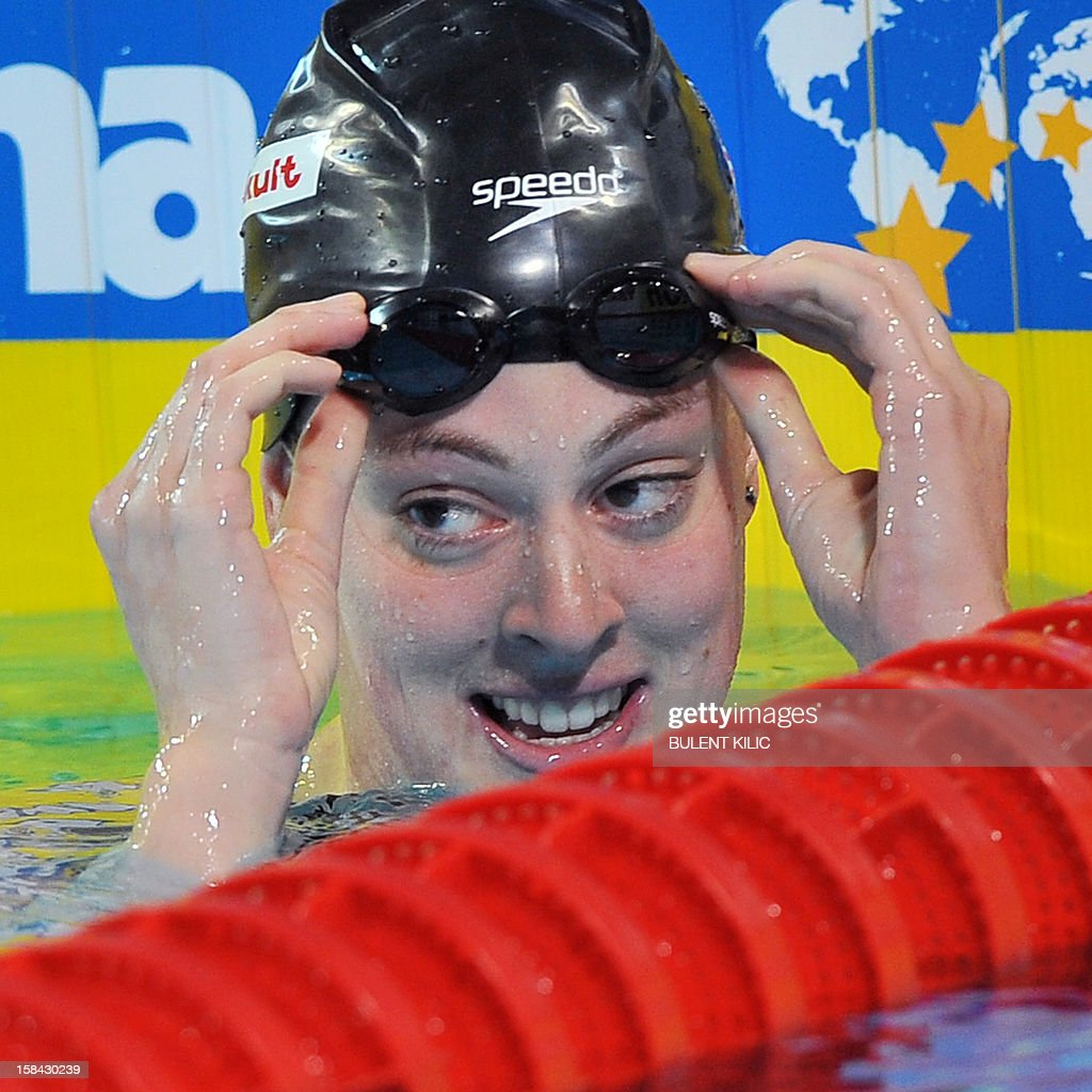 Allison Schmitt of US celebrates her gold medal in the women`s 200m freestyle final during the Short Course Swimming World Championships in Istanbul on December 16, 2012.