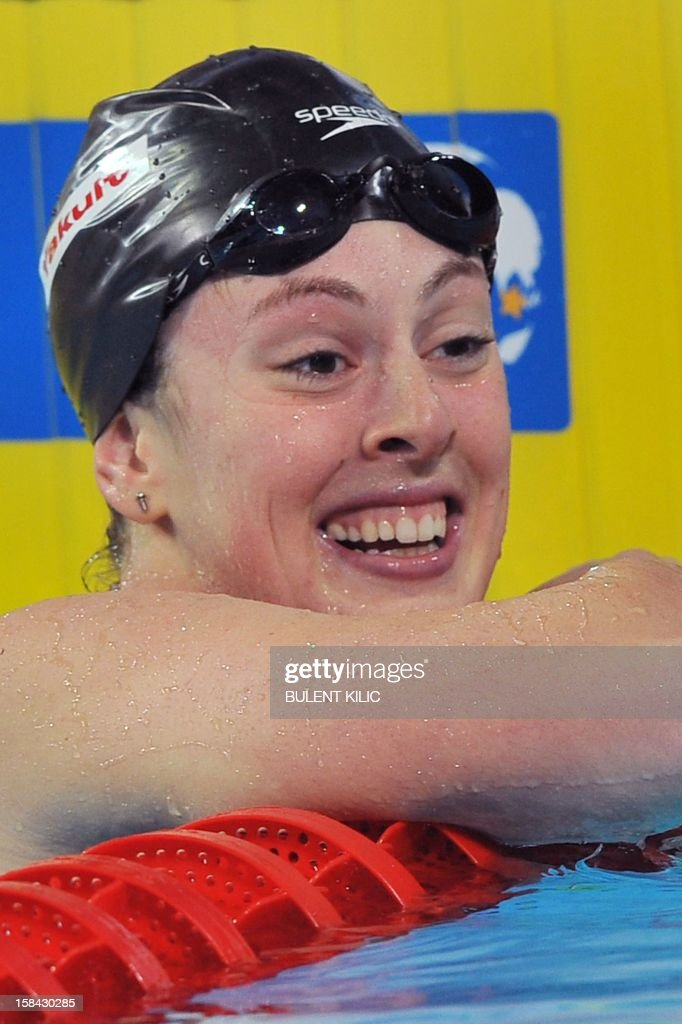 Allison Schmitt of US celebrates her gold medal in the women`s 200m freestyle final during the Short Course Swimming World Championships in Istanbul on December 16, 2012. AFP PHOTO/BULENT KILIC