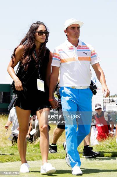 Allison Stokke and Rickie Fowler of the United States walk off the course during the first round of the 2017 US Open at Erin Hills on June 15 2017 in...