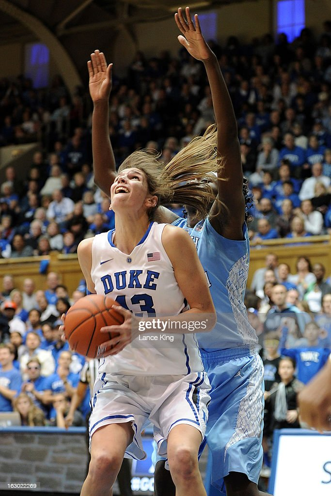 Allison Vernerey #43 of the Duke Blue Devils goes to the hoop against Waltiea Rolle #32 of the North Carolina Tar Heels at Cameron Indoor Stadium on March 3, 2013 in Durham, North Carolina.