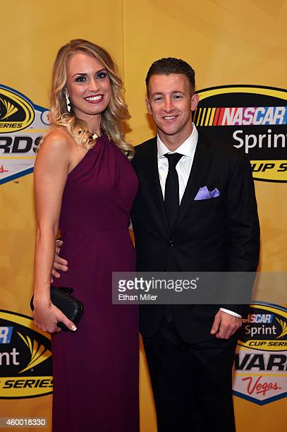 Allmendinger and Tara Lea arrive on the red carpet prior to the 2014 NASCAR Sprint Cup Series Awards at Wynn Las Vegas on December 5 2014 in Las...