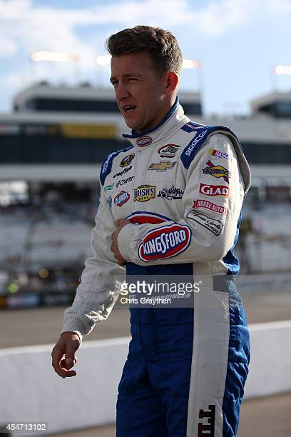 Allmendinger driver of the Bush's Beans Chevrolet walks on the grid prior to qualifying for the NASCAR Sprint Cup Series Federated Auto Parts 400 at...