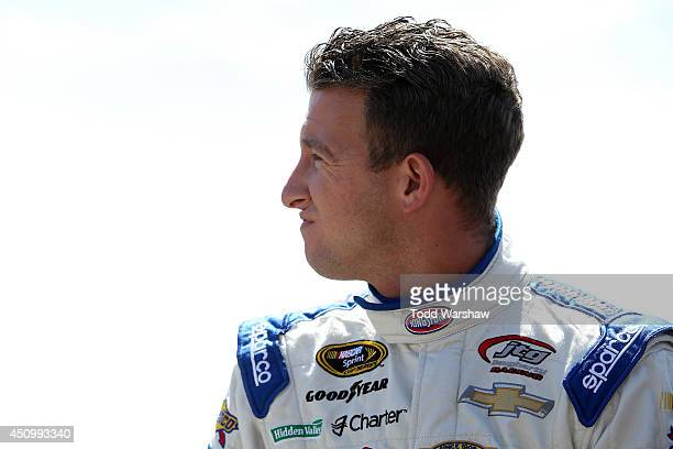 Allmendinger driver of the Clorox/Kingsford Chevrolet stands on the grstands on the gridduring qualifying for the NASCAR Sprint Cup Series...