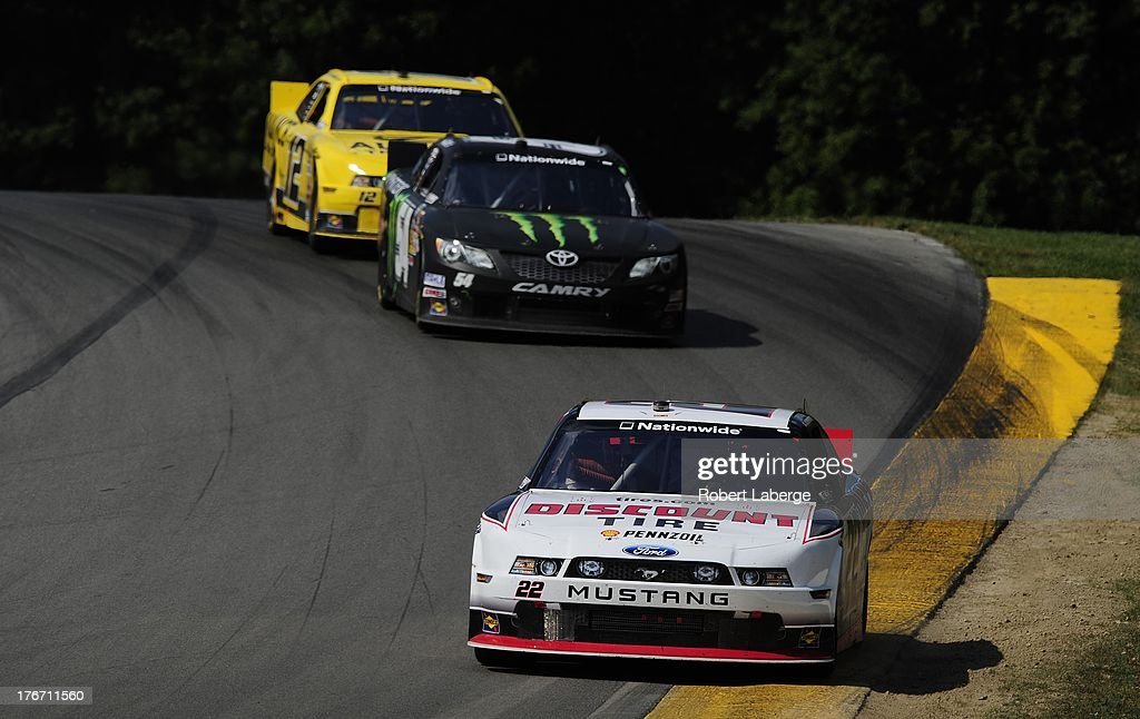 AJ Allmendinger, driver of the #22 Discount Tire Ford, leads a pack of cars during the NASCAR Nationwide Series Children's Hospital 200 at the Mid-Ohio Sports Car Course on August 17, 2013 in Lexington, Ohio.