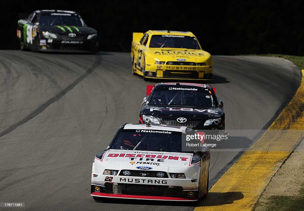 AJ Allmendinger, driver of the #22 Discount Tire Ford, leads Michael McDowell, driver of the #18 K-Love Toyota, during the NASCAR Nationwide Series Children's Hospital 200 at the Mid-Ohio Sports Car Course on August 17, 2013 in Lexington, Ohio.